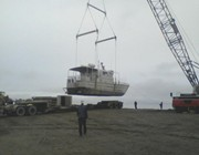 Getting craned off the truck at F Pad — in Prudhoe Bay, AK.